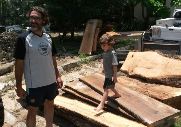 Daniel and his best little helper taking a break from harvesting fine lumber from fallen trees.